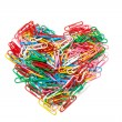 Multi color paper clips arranged in heart shape — Stock Photo #58920459