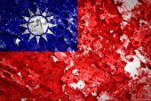 Taiwan grunge flag painted on brick wall — Zdjęcie stockowe
