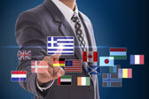 Businessman choosing Greece Flag — Stock Photo