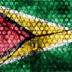Guyana flag on grunge rubber — Stock Photo #59366237