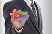 Businessman in suit holding Eritrea Flag — Stock Photo