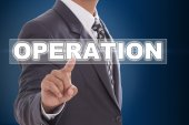 Businessman hand touching operation on screen — Stock Photo