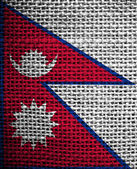 Texture of sackcloth with the image of the Nepal flag — Stock Photo