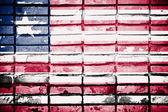 Liberia flag on old brick wall — Stock Photo