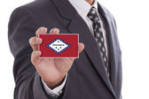 Businessman with Arkansas State Flag — Stock Photo
