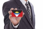 Businessman with Antigua and Barbuda Flag — Stock Photo