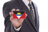 Antigua and Barbuda Flag in hand — Stock Photo