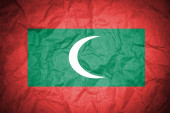 Maldives flag on old paper — Stock Photo