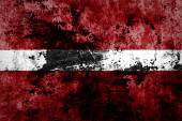 Latvia flag on grunge wall — Stock Photo