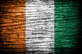 Ivory Coast Flag on old wood texture — Stock Photo