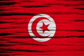 Tunisia Flag on old wood texture — Stock Photo