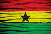 Ghana Flag on old wood background — Stock Photo