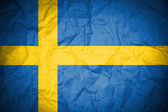Sweden flag painted on crumpled paper — Stock Photo