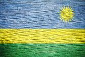 Rwanda Flag on old wood texture — Stock Photo