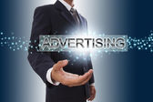 Businessman with advertising word. — Stock Photo