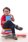 Cute boy sit and holding books — Stock Photo