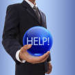 Businessman hand holding blue crystal ball with ticket word. — Stock Photo #61174915