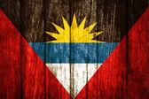 Antigua and Barbuda on old wood background — Stock Photo