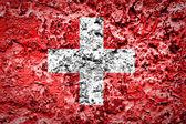 Switzerland flag on concrete wall — Stock Photo