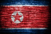North Korea Flag painted on old wood texture — Stock fotografie