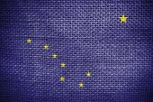 Texture of sackcloth with the image of Alaska State flag — Stock Photo