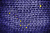 Texture of sackcloth with the image of Alaska State flag — Foto Stock
