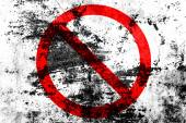 Forbidden sign painted on a grunge background — Stock Photo