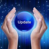 Hand showing blue crystal ball with update word. — Stock Photo