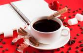 A cup of coffee with a pin and heart on red background with spic — Zdjęcie stockowe