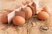 Eggs and hay on wooden background. Selective focus — Stock Photo