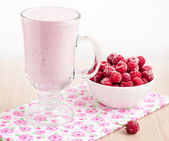 Healthy raspberry smoothie on wooden background. — Stock Photo