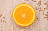 Half an orange on the table closeup — Stock Photo