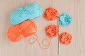 Handmade knitted crochet flowers — Stock Photo