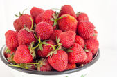 Strawberry berries close up in a rustic bowl on a white backgrou — Stock Photo