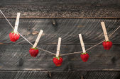 Summer fresh strawberries with pin hanging on a clothesline on a — Stock Photo
