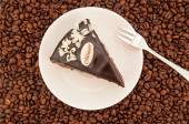 Chocolate cake with coffee beans — Stock Photo