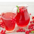 Juice of red currants close up on wooden background — Stock Photo #79160742