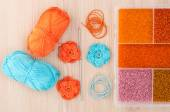 Handmade knitted crochet flowers and box with beads to create ha — Stock Photo