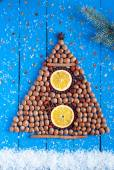 Christmas tree made of nuts and dried fruits on the wooden backg — Stock Photo