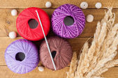 Yarn for knitting and wooden beads on a table. Accessories for k — Stock Photo