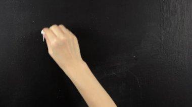 Hello written on blackboard chalkboard chalk — Stok video