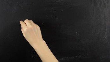 Spanish hello hola written on blackboard chalkboard chalk — Stockvideo