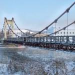 The bridge over the freezing river — Stock Photo #56483459