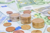 Euro banknotes and euro coins in simple example  — Stock Photo