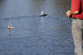 Model boat leads to the water — Stock Photo