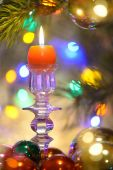 Beautiful Christmas decorations with burning candle — Stock Photo