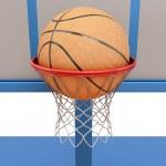 Basketball ball falling into a ring close-up — Stock Photo #68782519