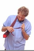 Man trying to bind a tie  — Stock Photo