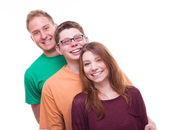 Three Friends standing and laughing  - studio shot  — Stok fotoğraf