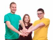 Three people team keeps on with your hands — Stock Photo